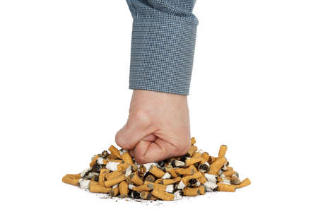 fist is punching heap of cigarettes Stock Photo - 17307699