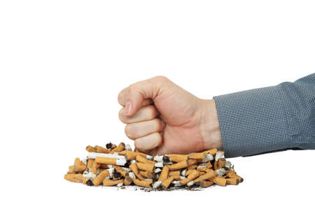 smokers fist on heap of cigarettes photo