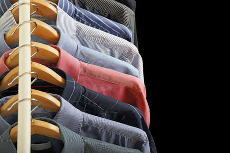 variety of shirts on hangers Imagens
