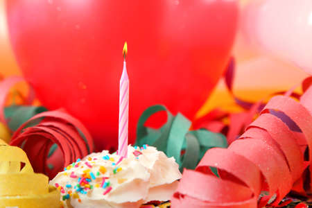 happy birthday balloons: pink candle with balloons and streamers
