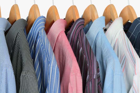 variety of shirts on hangers Stock Photo