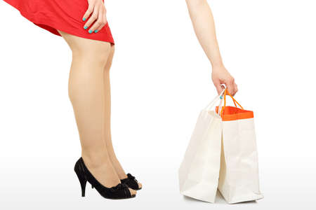 stylish woman is picking up a shopping bag Stock Photo - 18082582