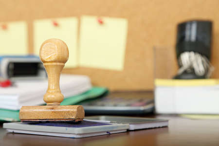 corkboard: office stamp in front of office items