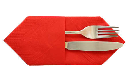 fork and knife in napkin isolated photo