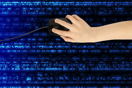 boys hand with computer mouse on futuristic background  photo
