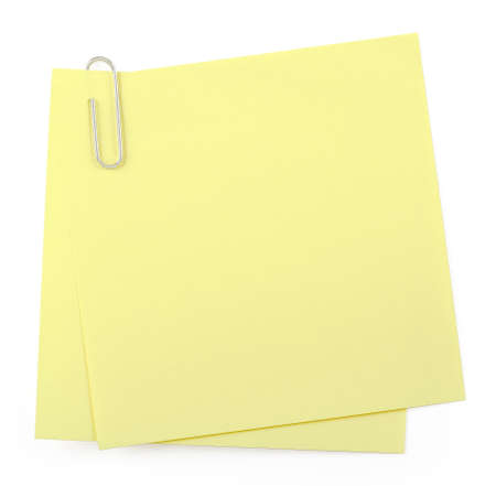 post it: post it notes with paper clip on white