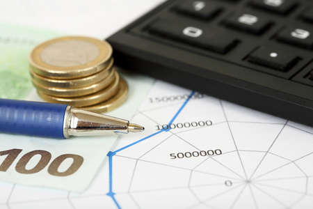 pen, money and calculator on graph Stock Photo - 19480551