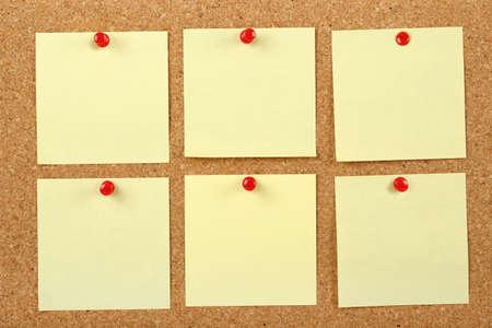 postits: six post it notes on corkboard