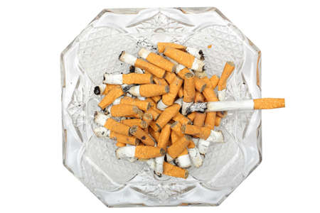 ashtray with burning cigarette and butts isolated photo