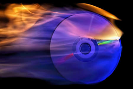 back up: cd is on fire against black background