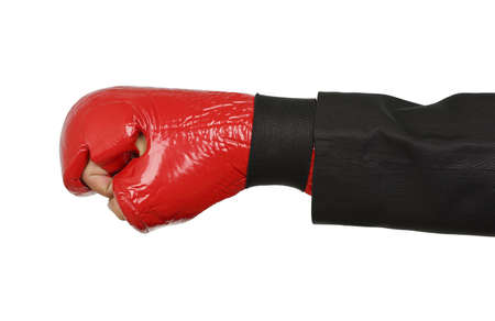 businessmans hand with boxing glove isolated photo
