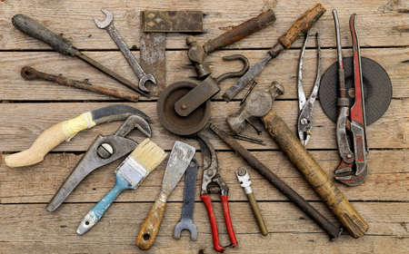 rusty nail: variety of old tools on wood