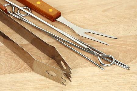 bbq utensils on wood closeup