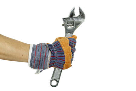 hand in protective glove with spanner isolated photo