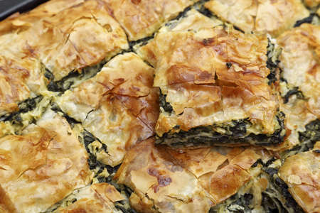 filo pastry: freshly baked spinach pie closeup
