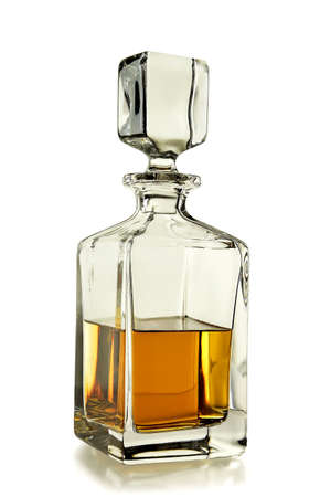 decanter with whiskey on white background photo