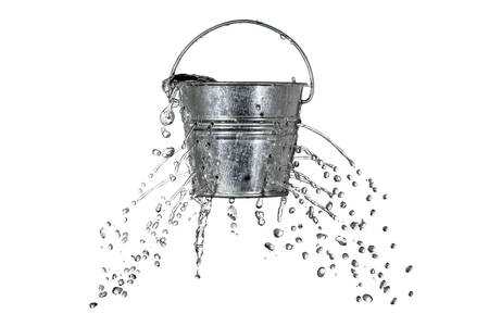 out of water: water is coming out of a bucket with holes