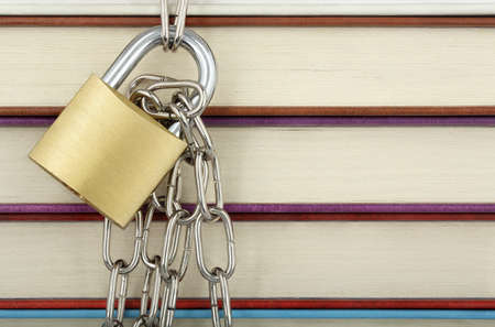 padlock with chain against books closeup Stock Photo - 24529668