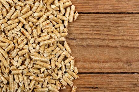 wood pellets on planks closeup