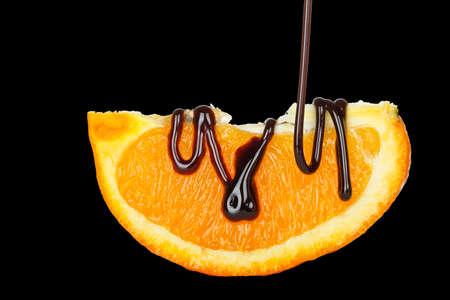 orange slice: pouring chocolate syrup on orange slice