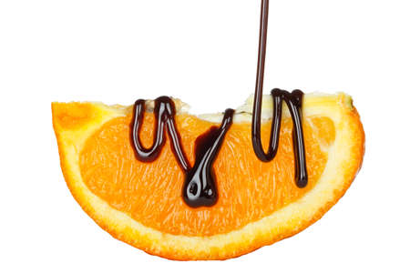 chocolate slice: pouring chocolate syrup on orange slice