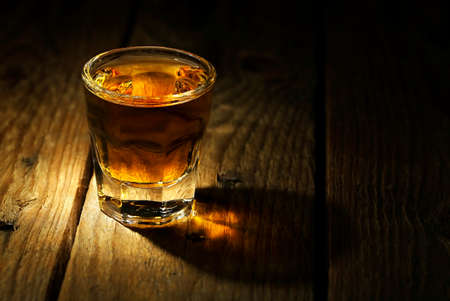 whiskey on old wooden surface photo