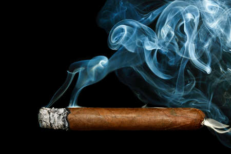 cigar with smoke on black background
