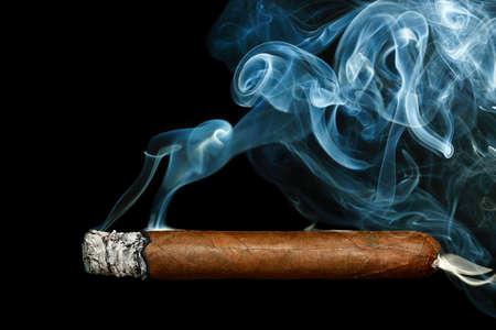 cigar smoke: cigar with smoke on black background