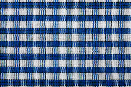 checked shirt:  blue and white checked shirt closeup