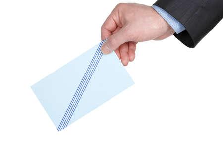 designate: man s hand with ballot voting Stock Photo