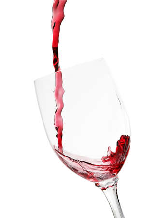 red wine being poured into glass isolated photo