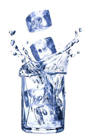 ice cubes falling into glass of water  photo