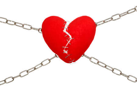 broken unity: concept with broken heart and chains on white Stock Photo
