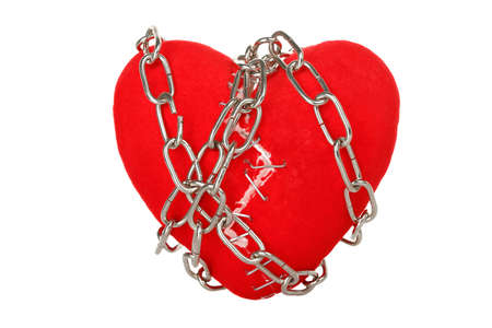 broken unity: chain wrapped around broken heart with staples isolated