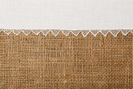 burlap sack: doily with handmade lace on burlap texture