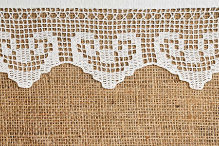 sack cloth: handmade lace on burlap for backgrounds Stock Photo