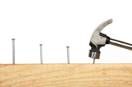 consecutive: hammering consecutive nails on wood Stock Photo