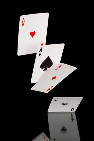 four falling aces isolated on black