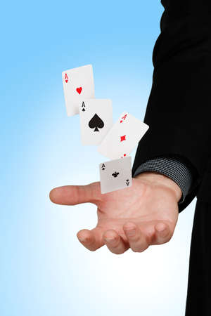fortunate: four aces falling into a mans hand Stock Photo