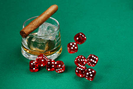 red dice: red dice rolling over green felt with whiskey and cigar