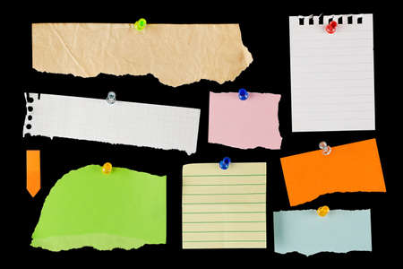noteboard: variety of blank torn notes on black background
