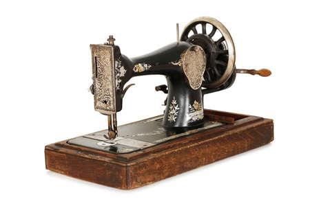 antieke naaimachine op wit wordt geïsoleerd Stockfoto