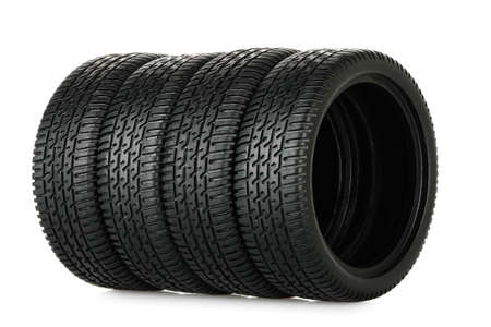 set of miniature tires isolated on white photo