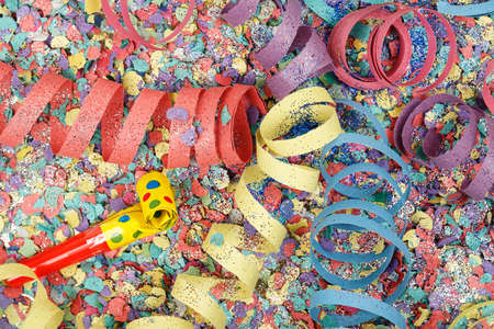 noisemaker: colorful party streamers on confetti Stock Photo