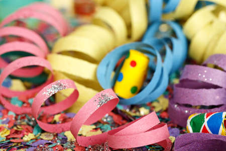 party streamers: closeup of colorful party streamers on confetti