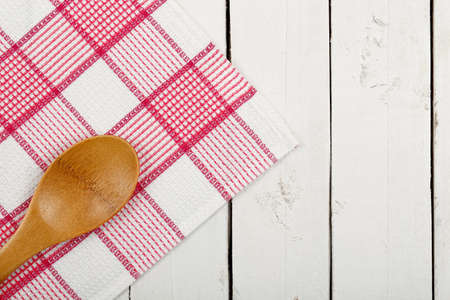 ladle: napkin and wooden ladle on white planks