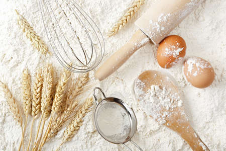 bakery products: variety of objects on flour surface, baking or flour background