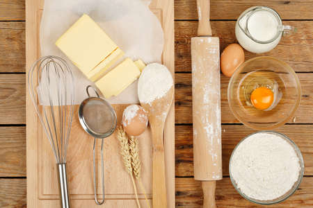 baking ingredients: baking preparation, top view of a variety of objects on wooden planks