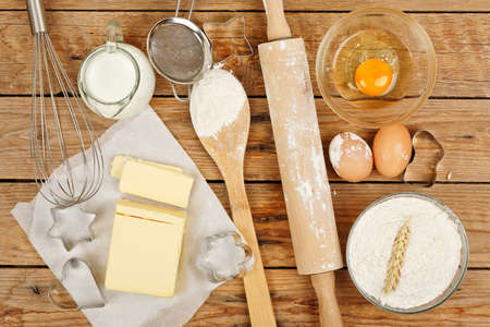 baking preparation, top view of a variety of objects on wooden planks