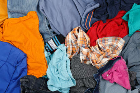 messy clothes: large variety of wrinkled clothes, full frame